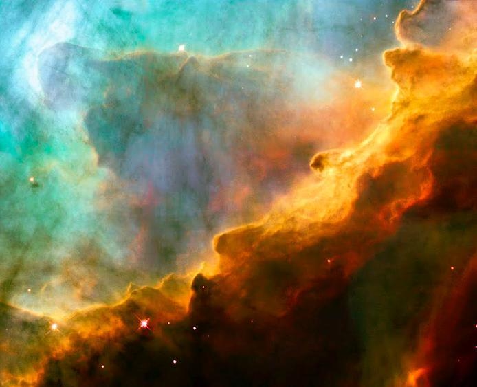 """Цей космічний """"привид"""" відлітаючий із хмари газу в Туманності Омеги"""