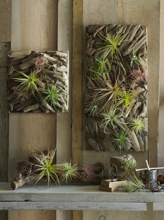 Декоративне панно з гілок і штучних рослин, яке можна змайструвати своїми руками.